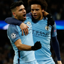 Manchester City's Sergio Aguero (left) celebrates scoring his side's third goal with Leroy Sane