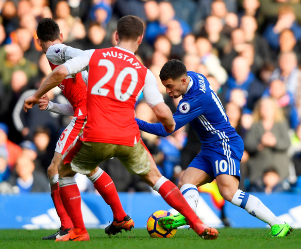 Eden Hazard is pictured here on the way to scoring his wonder-goal in the Premier League win over Arsenal at Stamford Bridge.