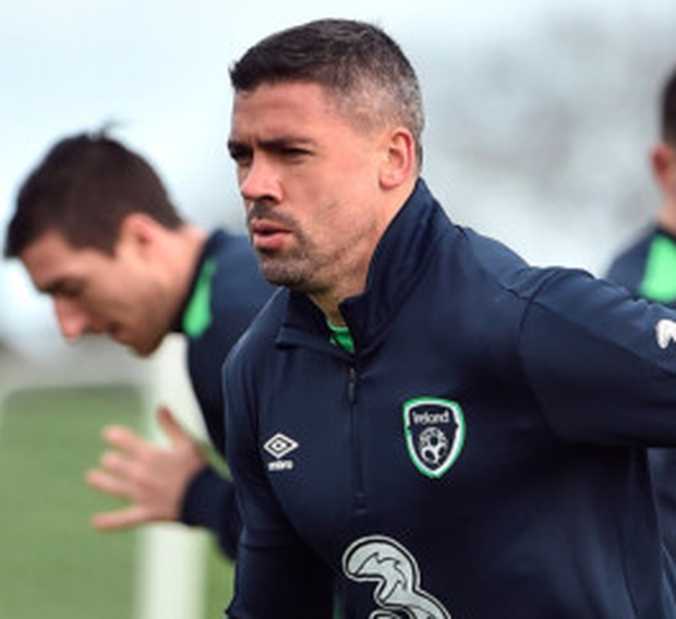Ireland striker Jonathan Walters limbers up during squad training at the FAI National Training Centre in Abbotstown, Dublin ahead of Friday's World Cup qualifier against Wales. Photo: David Maher/Sportsfile