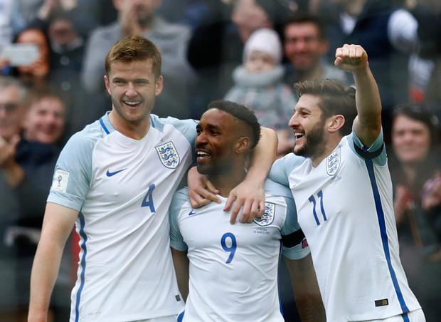 England's Jermain Defoe celebrates scoring their first goal against Lithuania with Eric Dier and Adam Lallana at Wembley yesterday. Photo: REUTERS