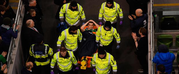 Ireland captain Seamus Coleman being stretchered off with a broken leg. Photo: SPORTSFILE