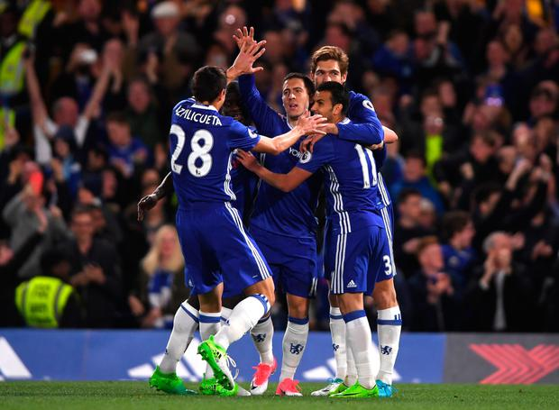 Chelsea's Eden Hazard is mobbed by his team-mates after scoring his second goal in last night's win over Manchester City. Photo: GETTY