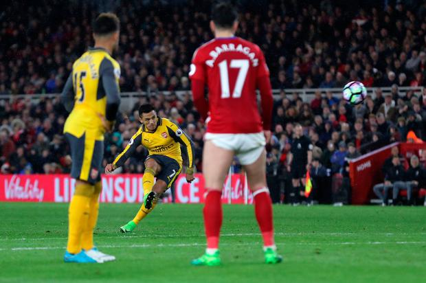 Arsenal's Alexis Sanchez pictured scoring from a free-kick during the Premier League match at the Riverside Stadium, Middlesbrough. Photo: PA