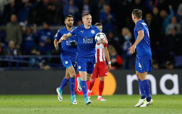 Leicester City's Jamie Vardy celebrates scoring their first goal with team mates. Photo: Reuters