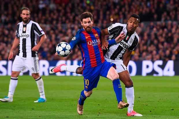 Barcelona forward Lionel Messi vies with Juventus' defender Alex Sandro during the Champions League quarter-final second leg at the Nou Camp stadium. Pic: Getty Images