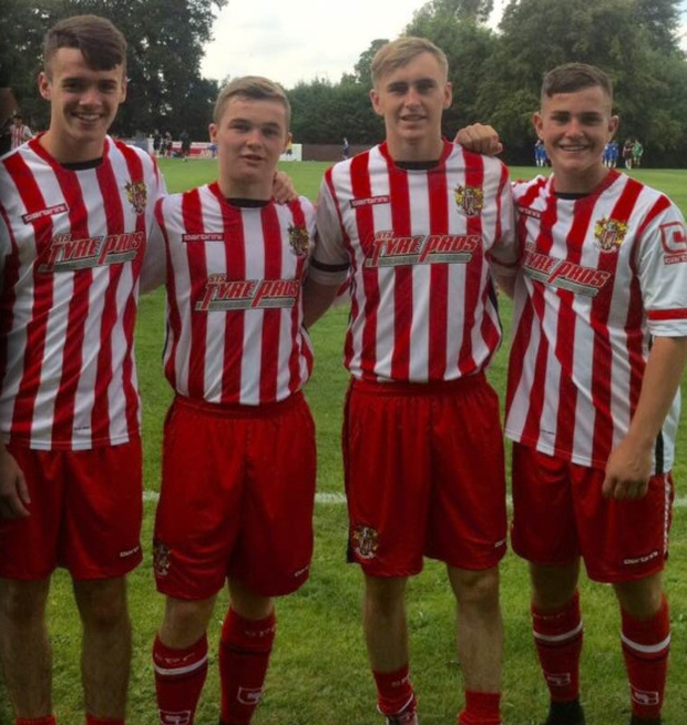 The four St Kevin's Boys players Liam Brady, Mikey Cregan, Luke Wade-Slater and Jamie Gray following their official signing at Stevenage's Braghall Way training ground