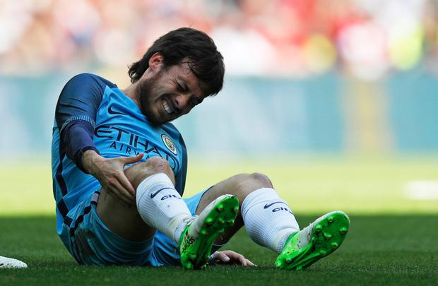 David Silva is pictured after sustaining an injury in last Sunday's FA Cup semi-final. photo: Darren Staples/Reuters