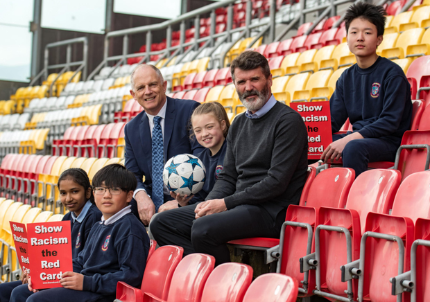 At the annual Show Racism the Red Card awards ceremony yesterday at Tallaght Stadium were (from left) Laya Susansabu, Andrew Tran, David Stanton TD, Minister of State at the Department of Justice and Equality, Chantelle Doyle, Ireland assistant manager Roy Keane and Huimi Roy