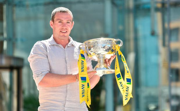 Richard Dunne shows off the FAI Junior Cup Picture: Sportsfile