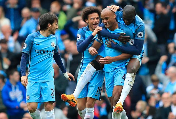 Manchester City players mob Vincent Kompany after scoring in Saturday's win over Crystal Palace. Photo: PA