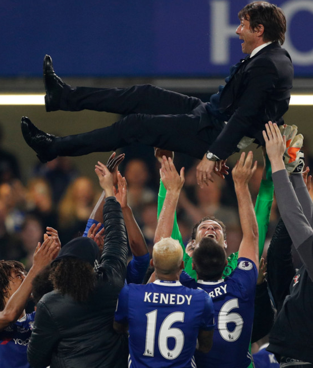 Chelsea players lift manager Antonio Conte in the air following their 4-3 Premier League win over Watford at Stamford Bridge last night. Photo: Reuters