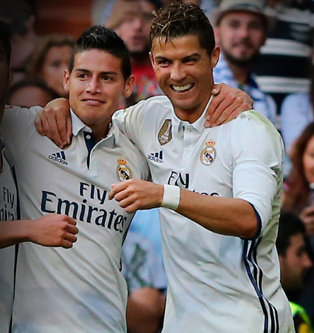 Real Madrid striker James Rodriguez, pictured (l) with former Manchester United star Cristiano Ronaldo