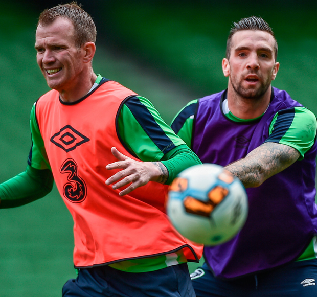 Shane Duffy gets to grips with Glenn Whelan during Ireland training. Photo: Sportsfile