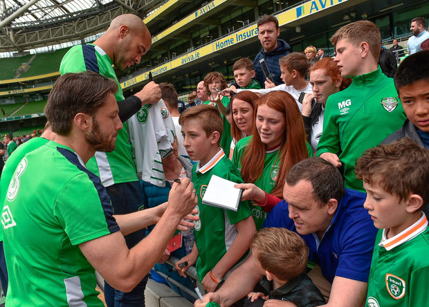 Ireland players Darren Randolph and Harry Arter sign autographs for fans after training at the Aviva Stadium yesterday. Photo: Sportsfile