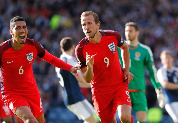 England's Harry Kane celebrates scoring their second goal with Chris Smalling. Photo: Reuters