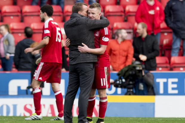 Jonny Hayes embracing Celtic boss Brendan Rodgers during his time at Aberdeen