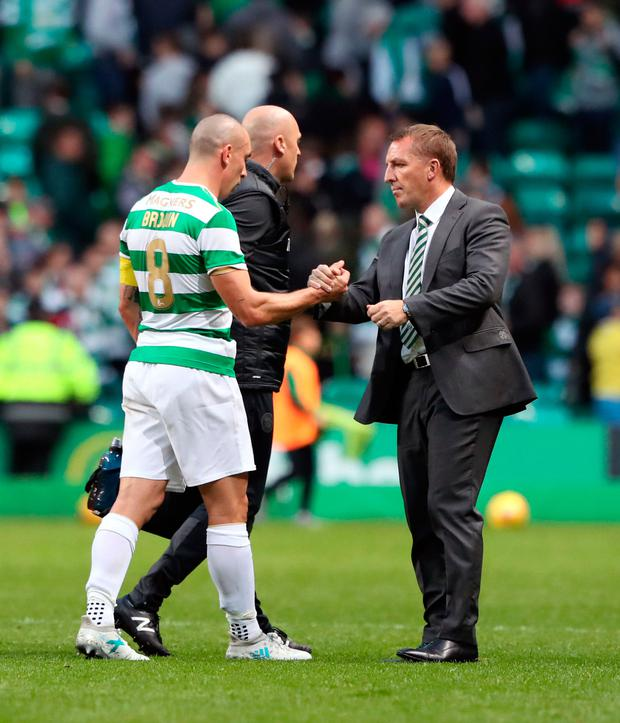 Celtic's Scott Brown shakes hands with Brendan Rodgers after last week's Champions League third round qualifying round, first leg match at Celtic Park, Glasgow