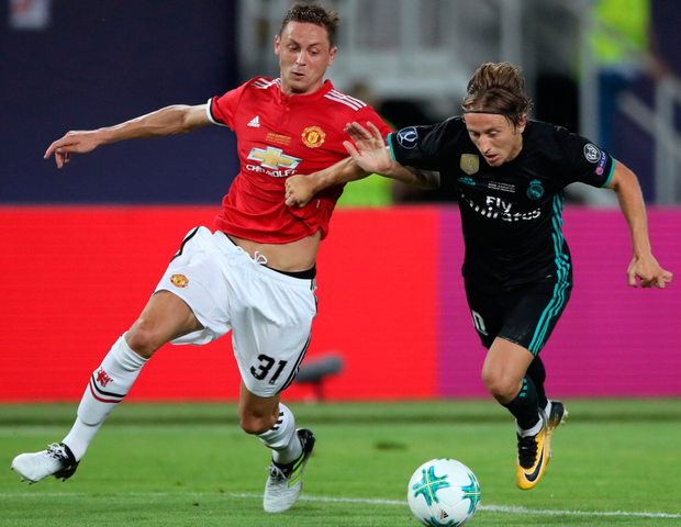 Manchester United's Nemanja Matic tussles with Real Madrid's Luka Modric during Tuesday night's UEFA Super Cup final