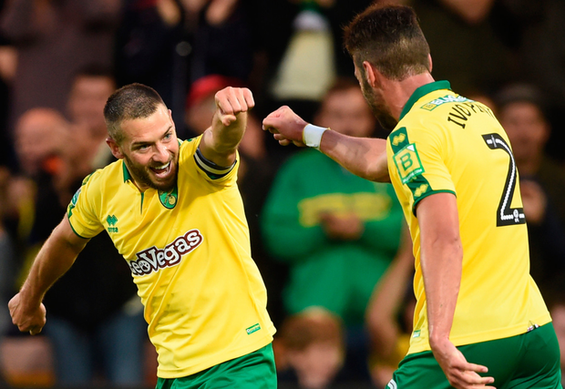 Norwich City's Wes Hoolahan (left) celebrates scoring his team's second goal during the League Cup first round win over Swindon on Tuesday