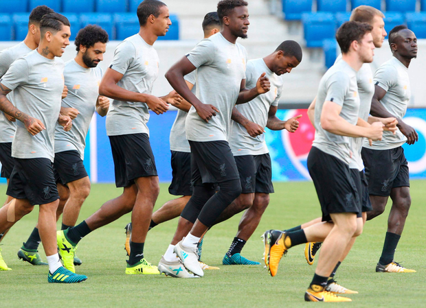 The Liverpool squad are pictured in training at the Wirsol Rhein Neckar Arena in Sinsheim, Germany, ahead of tonight's Champions League play-off first leg clash with Hoffenheim