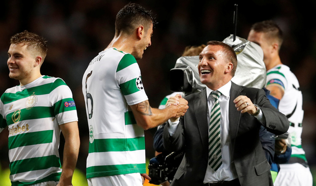 Brendan Rodgers, pictured here with Nir Bitton after Wednesday night's Champions League win over Astana, has worked wonders on a relatively small budget at Celtic. Photo: Reuters