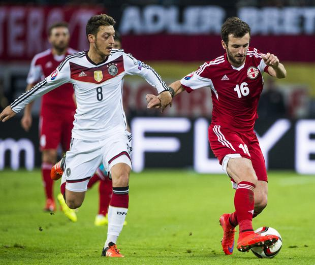 Georgia's Nika Kvekveskiri is pictured in action against Germany's Mesut Ozil during a Euro 2016 qualifier back in 2015