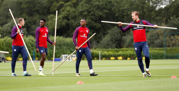 England's striker Harry Kane (r) is pictured in training with (l-r) Danny Welbeck and Daniel Sturridge ahead of tonight's clash with Slovakia at Wembley.