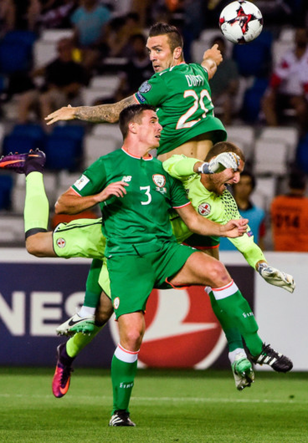 Shane Duffy heads Ireland into the lead in Tbilisi on Saturday.