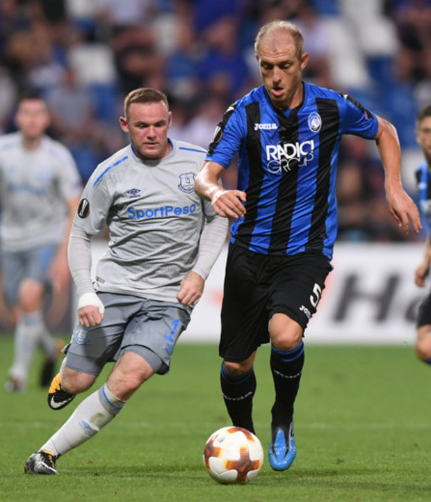 Everton's Wayne Rooney challenges Atalanta's Andrea Masiello during yesterday's Europa League clash in Reggio nell'Emilia, Italy.
