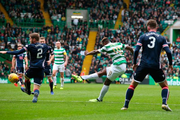 Moussa Dembele scores for Celtic in the Scottish Premiership win over Ross County on Saturday Photo: PA