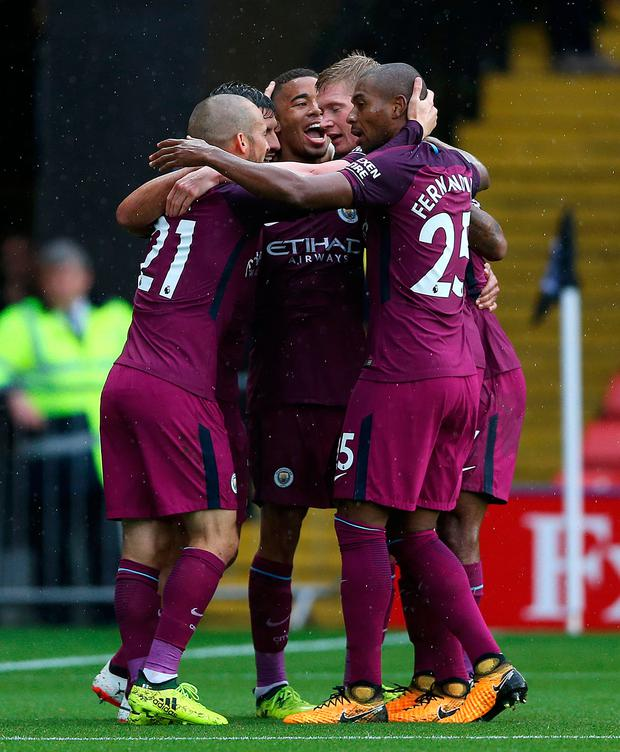 Manchester City's Gabriel Jesus (centre) celebrates scoring his side's third goal during the Premier League match at Vicarage Road, Watfo Photo: PA