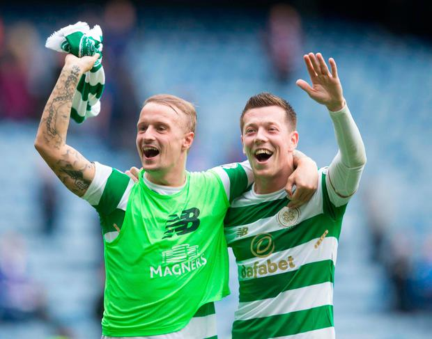 Celtic's Leigh Griffiths and Callum McGregor celebrate after the game at the Ibrox. Photo: PA