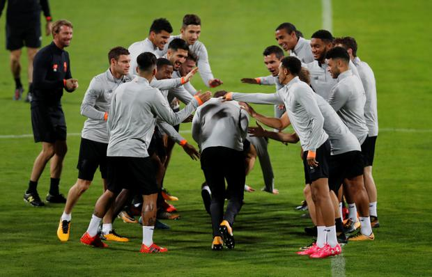 Liverpool players enjoy a light-hearted moment during training ahead of tonight's Champions League clash in Maribor, Slovenia. Pic: Reuters