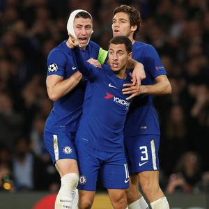 Chelsea's Eden Hazard celebrates scoring his side's third goal with Gary Cahill and Marcos Alonso.