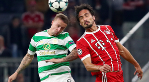 Celtic striker Leigh Griffiths (l) challenges Bayern Munich's Mats Hummels for the ball at the Allianz Arena last night.