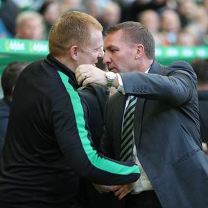(l-r) Hibernian manager Neil Lennon will do battle with his fellow Northern Irishman Brendan Rodgers at Hampden Park today for a place in the Betfred Cup final. Pic: Getty