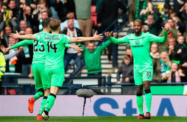 Celtic's Moussa Dembele (right) celebrates scoring his side's third goal with team-mates Mikael Lustig and Stuart Armstrong during the Betfred Cup semi-final win over Hibernian at Hampden Park, Glasgow on Saturday.