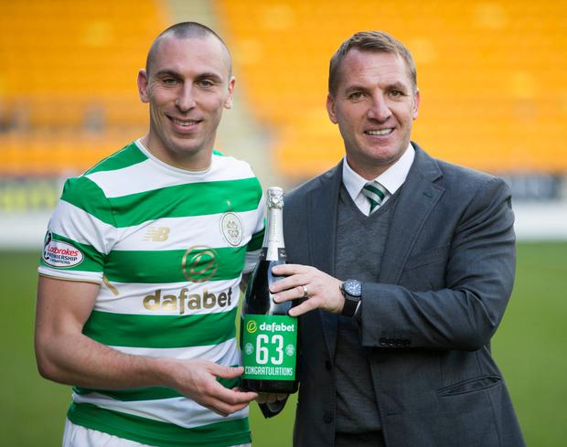 Celtic's Scott Brown and manager Brendan Rodgers. Photo: PA