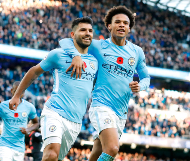 Manchester City's Sergio Aguero celebrates scoring his side's second goal of the game with teammate Leroy Sane