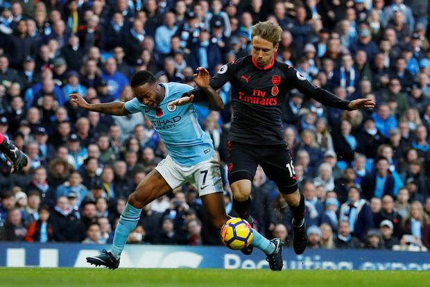 Manchester City's Raheem Sterling is brought down in the area by Arsenal's Nacho Monreal resulting in a penalty