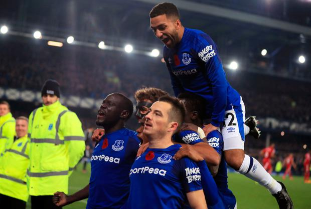 Everton's Leighton Baines (centre, bottom) celebrates scoring his side's third goal of the game from the penalty spot