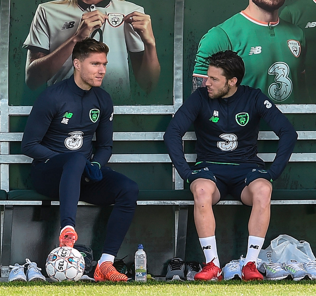 Ireland midfielder Harry Arter chats with Ireland team-mate Jeff Hendrick during squad training at Abbotstown yesterday
