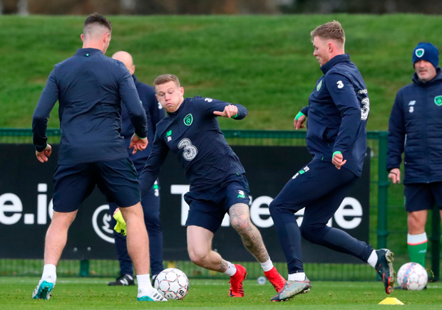 The Republic of Ireland's James McClean (c) slides in during a training session at Abbotstown this week.