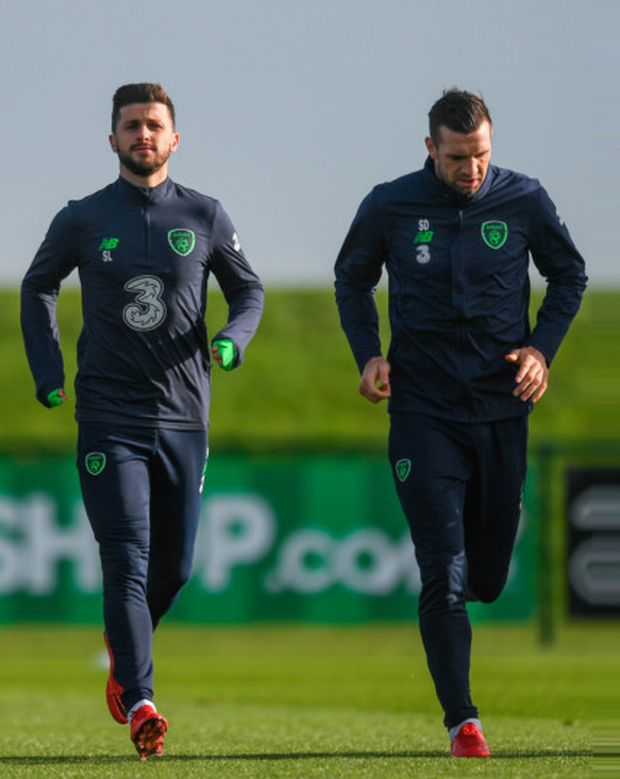 Ireland's Shane Long (left) and Shane Duffy are pictured in training ahead of tomorrow night's World Cup play-off first leg against Denmark in Copenhagen.