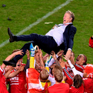 Denmark manager Age Hareide is hoisted by his squad after their win at the Aviva Stadium.