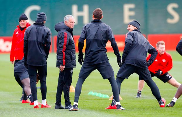Manchester United manager Jose Mourinho speaks with Manchester United's Nemanja Matic (centre) and Zlatan Ibrahimovic (right) during training ahead of tonight's Champions League clash with Basel. Photo: PA