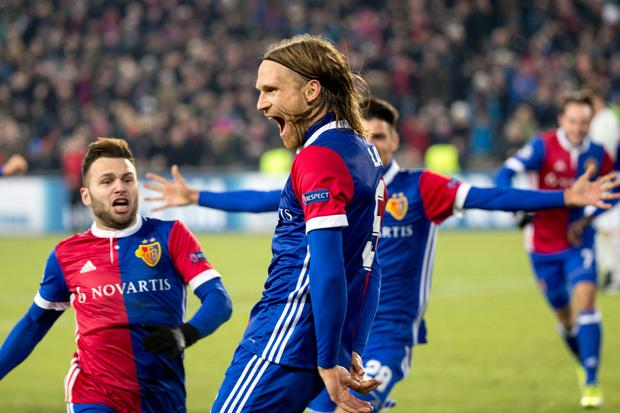 Basel's Michael Lang celebrates his winning goal against Manchester United last night.
