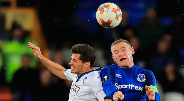 Everton's Wayne Rooney and Atalanta's Remo Freuler battle for the ball at Goodison Park last night