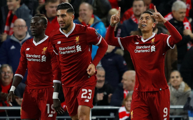Liverpool's Roberto Firmino celebrates scoring their third goal with team-mates Sadio Mane (left) and Emre Can