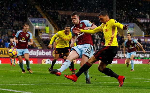 Burnley's Irish defender Kevin Long, pictured in action against Watford's Jose Holebas last Saturday, is likely to take his place again in the Clarets' line-up for tonight's Premier League clash with Stoke City. Pic: Reuters